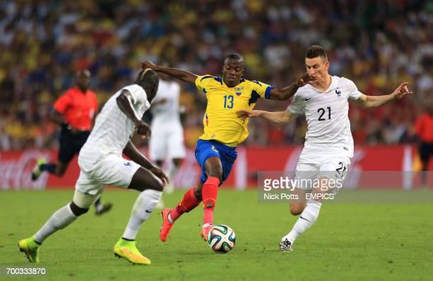 Ecuador's Enner Valencia battles for the ball with France's Laurent Koscielny