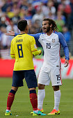 Ecuador's Fernando Gaibor and USA's Kyle Beckerman argue during their Copa America Centenario football tournament quarterfinal match in Seattle...