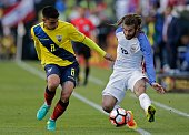 Ecuador's Fernando Gaibor and USA's Kyle Beckerman vie for the ball during their Copa America Centenario football tournament quarterfinal match in...