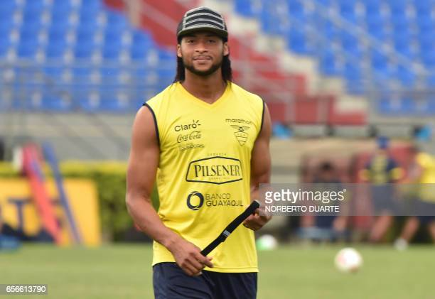 Ecuador's footballer Arturo Mina talks takes part of a training session at Arsenio Erico stadium in Asuncion ahead of their FIFA World Cup qualifying...