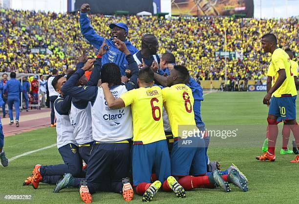 Ecuador's footballers celebrate after Ecuador's Fidel Martinez scored against Uruguay during their Russia 2018 FIFA World Cup South American...