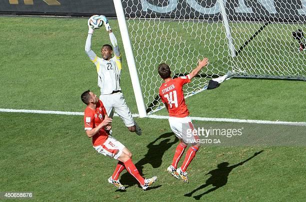 Ecuador's goalkeeper Alexander Dominguez gets to the ball ahead of Switzerland's forward Josip Drmic and Switzerland's midfielder Valentin Stocker...