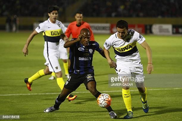 Ecuador´s Independiente del Valle player José Angulo vies for the ball with Argentinian´s Boca player Leonardo Jara during the Libertadores football...