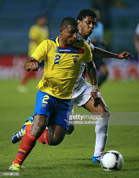 Ecuador's Jorge Guagua vies for the ball with Hondura's Anthony Lozano during a FIFA friendly football match at George Capwell stadium in Guayaquil...
