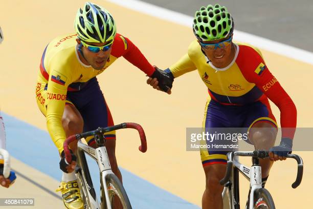 Ecuador's Jorge Ragonesi and Byron Guana compete during the ciclyng event as part of the XVII Bolivarian Games Trujillo 2013 at Colegio San Agustin...