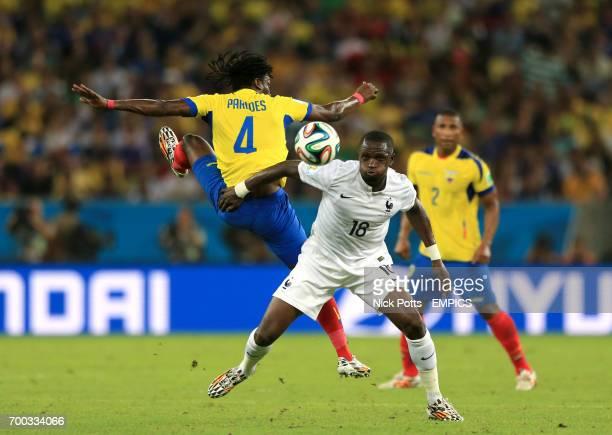 Ecuador's Juan Carlos Paredes and France's Moussa Sissoko battle for the ball