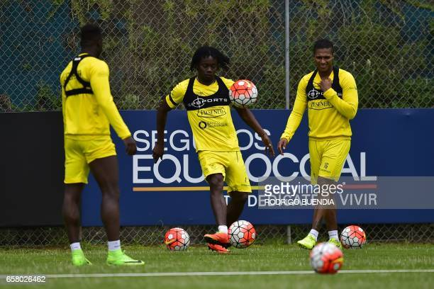 Ecuador's Juan Carlos Paredes Felipe Caicedo and Antonio Valencia take part in a training session in Quito on 26 March 2017 ahead of their FIFA World...