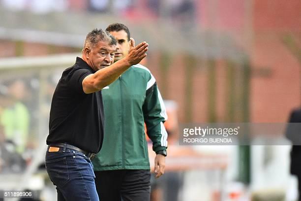 Ecuador's Liga de Quito coach Claudio Borghi gestures during their Copa Libertadores football match against San Lorenzo at Casa Blanca stadium in...
