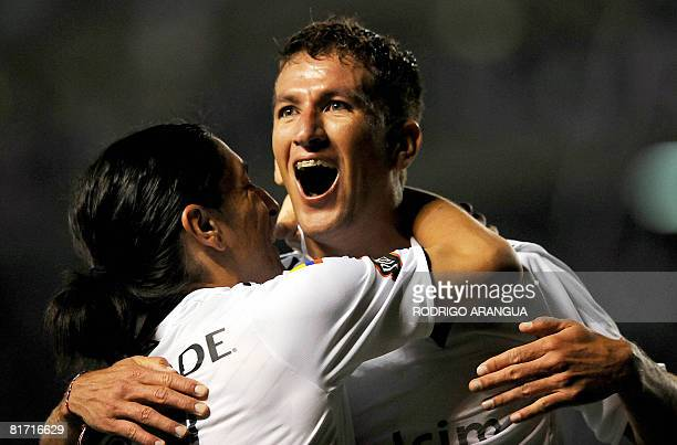 Ecuador`s Liga de Quito midfielder Patricio Urrutia celebrates after scoring against Brazil's Fluminense during the first leg football match of the...