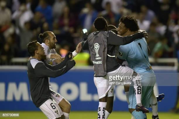 Ecuador's Liga de Quito player celebrate their win over Bolivar from Bolivia at the end of their 2017 Copa Sudamericana football match at Casa Blanca...