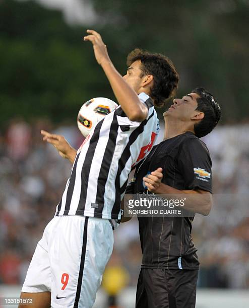 Ecuador's Liga Deportiva de Quito Norberto Araujo vies for the ball with Paraguayan Libertad's Velazquez during their Copa Sudamericana football...