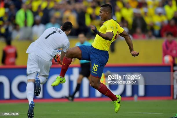 Ecuador's Luis Antonio Valencia vies for the ball with Colombia's goalkeeper David Ospina during their 2018 FIFA World Cup qualifier football match...