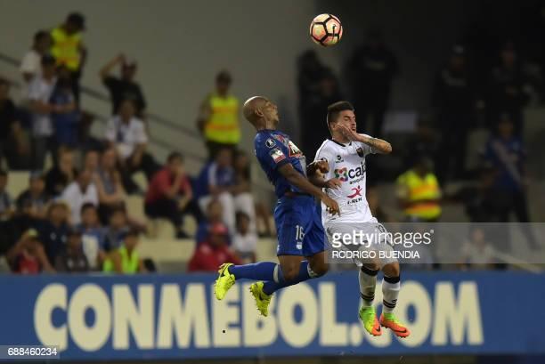 Ecuador's Melgar player Victor Cedron vies for the ball with Peru's Emelec player Oscar Bagui during their 2017 Copa Libertadores football match at...