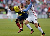 Ecuador's Michael Arroyo and USA's Geoff Cameron vie for the ball during their Copa America Centenario football tournament quarterfinal match in...
