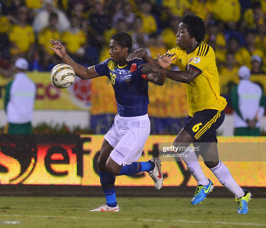 Ecuador's midfielder Antonio Valencia (L) is marked by Colombia's midfielder Carlos Sanchez during their Brazil 2014 FIFA World Cup South American qualifier match, in Barranquilla, Colombia, on September 6, 2013.