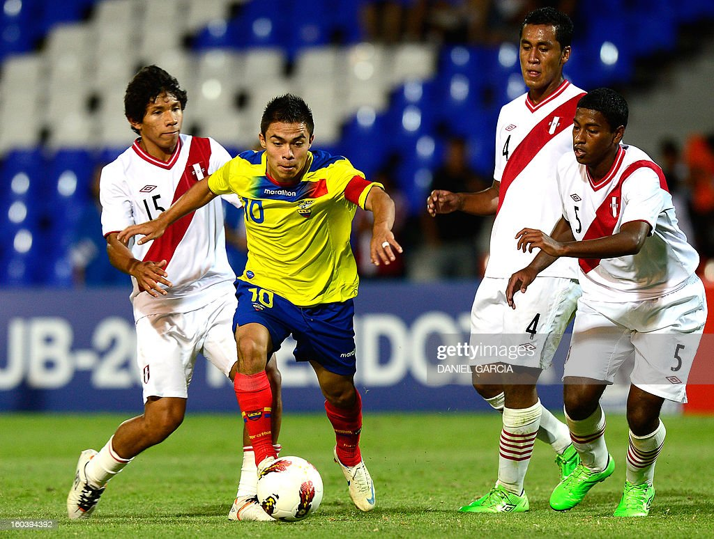 Ecuador's midfielder Jonny Uchuari (2nd L) vies for the ball with Peru's midfielder Edison Flores (L), defender Renato Tapia and defender Miguel Araujo (R), during their South American U-20 final round football match at Malvinas Argentinas stadium in Mendoza, Argentina, on January 30, 2013. Four South American teams will qualify for the FIFA U-20 World Cup Turkey 2013. AFP PHOTO / DANIEL GARCIA
