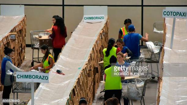 Ecuador's National Electoral Council personnel verify electoral material in the outskirts of Quito on March 22 2017 On April 2 Ecuador will hold a...