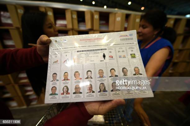 Ecuador's National Electoral Council personnel verify the electoral material in the outskirts of Quito on February 14 2017 More than 128 million...
