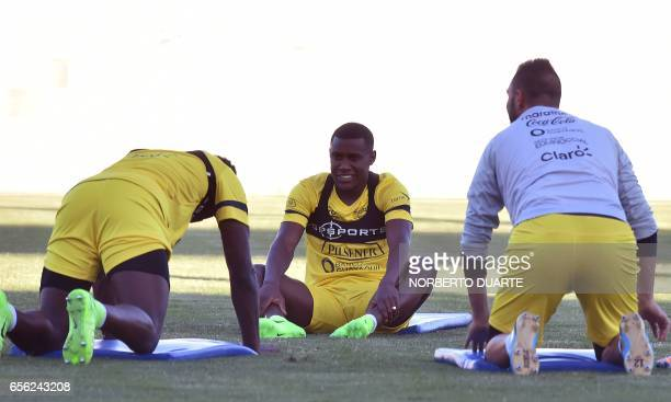 Ecuador's national footballer Juan Carlos Paredes stretches during a training session at Arsenio Erico stadium in Asuncion ahead of their FIFA World...