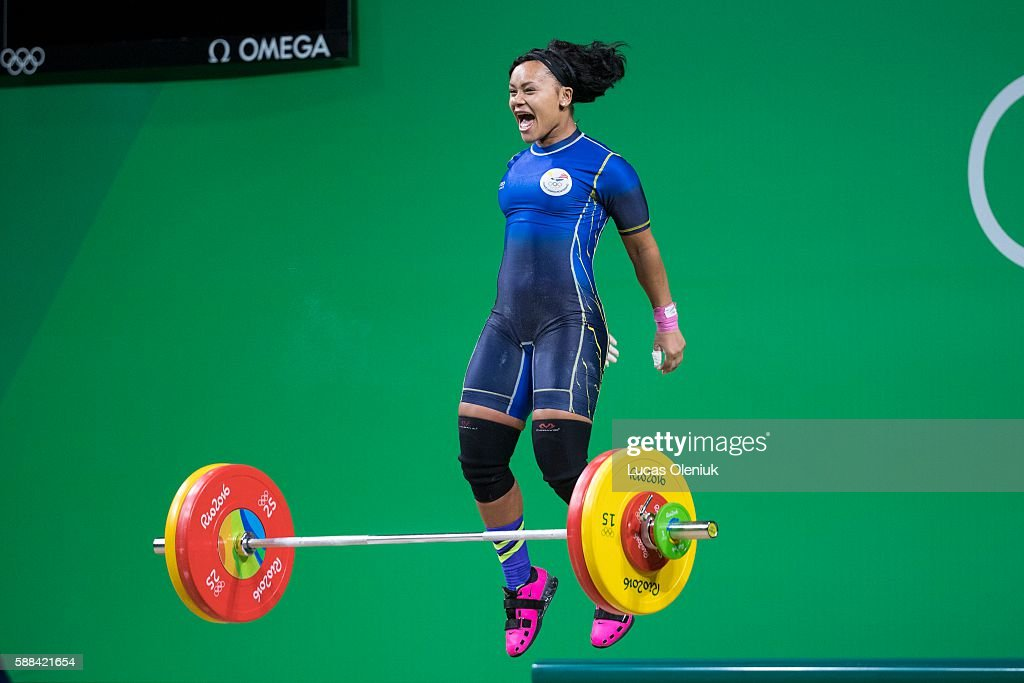 Ecuador's Neisi Patricia Dajomes Barrera cheers after a successful lift at 130kg in the clean and jerk portion of the women's 69kg weightlifting...