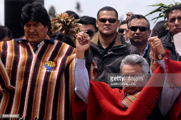 Ecuador's new President Lenin Moreno accompanied by Bolivian President Evo Morales takes part in an indigenous ritual where he is handed a ceremonial...