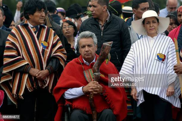 Ecuador's new President Lenin Moreno accompanied by his wife Rocio Gonzalez and Bolivian President Evo Morales is handed a ceremonial staff a...