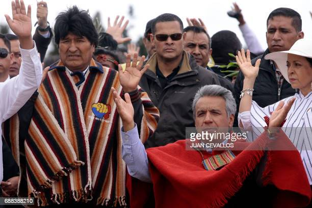 Ecuador's new President Lenin Moreno accompanied by his wife Rocio Gonzalez and Bolivian President Evo Morales speaks during an indigenous ritual...