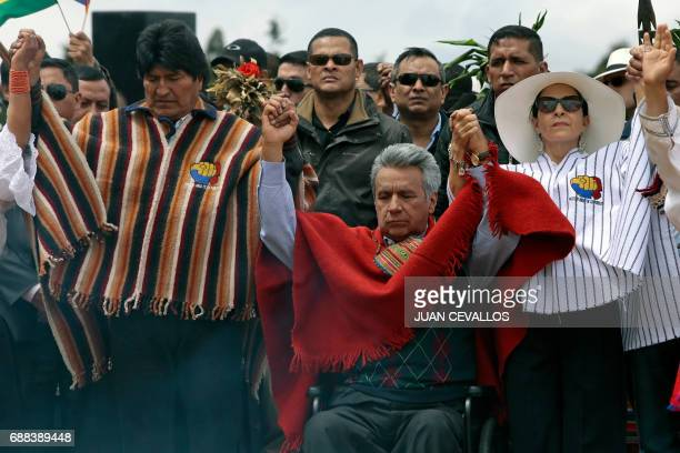 Ecuador's new President Lenin Moreno accompanied by his wife Rocio Gonzalez and Bolivian President Evo Morales takes part in an indigenous ritual...