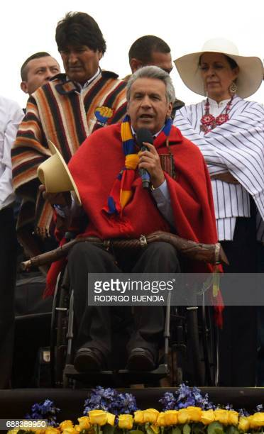 Ecuador's new President Lenin Moreno accompanied by his wife Rocio Gonzalez and Bolivian President Evo Morales speaks during an indigenous...