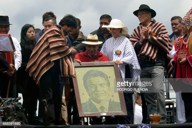 Ecuador's new President Lenin Moreno accompanied by his wife Rocio Gonzalez and VicePresident Jorge Glas receives a gift from Bolivian President Evo...