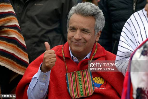 Ecuador's new President Lenin Moreno greets people during an indigenous ritual where he is handed a ceremonial staff a traditional symbol of...