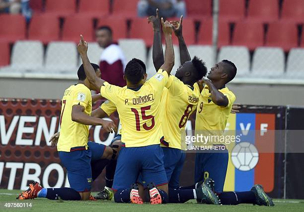 Ecuador's players celebrate after scoring against Venezuela during their Russia 2018 FIFA World Cup South American Qualifiers football match in...