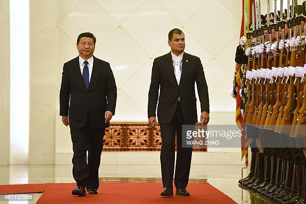 Ecuador's President Rafael Correa and Chinese President Xi Jinping inspect Chinese honour guards during a welcoming ceremony at the Great Hall of the...
