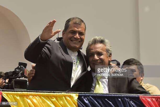 Ecuador's President Rafael Correa and Presidentelect Lenin Moreno greet supporters from a Carondelet presidential palace balcony in Quito on April 3...