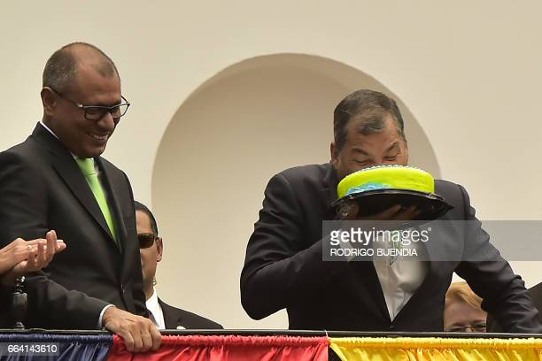 Ecuador's President Rafael Correa celebrates in advance with a birthday cake his April 6 anniversary next to President elect Lenin Moreno and...