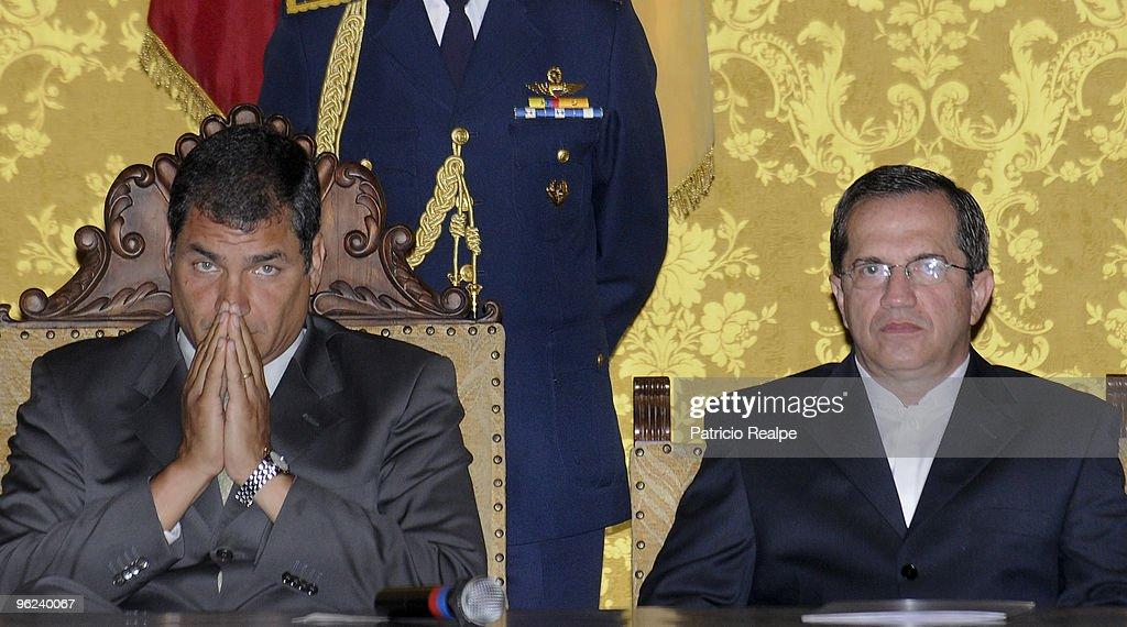 Ecuador's President <a gi-track='captionPersonalityLinkClicked' href=/galleries/search?phrase=Rafael+Correa&family=editorial&specificpeople=2294079 ng-click='$event.stopPropagation()'>Rafael Correa</a> (L) participates of the swearing in ceremony of the new Foreign Affairs Minister Ricardo Patino at the Government Palace on January 28, 2010 in Quito, Ecuador.