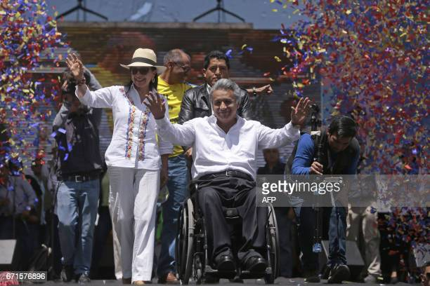 Ecuador's presidentelect Lenin Moreno flanked by his wife Rocio Gonzalez participates in a rally to celebrate his win in Quito on April 22 2107...