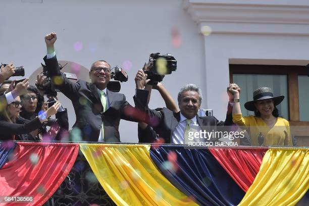 Ecuador's Presidentelect Lenin Moreno waves to supporters next to his wife Rocio Gonzalez and Vicepresidentelect Jorge Glas from the balcony of the...
