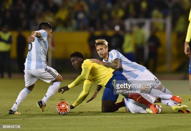Ecuador's Roberto Ordonez and Argentina's Lucas Biglia vie for the ball during their 2018 World Cup qualifier football match in Quito on October 10...