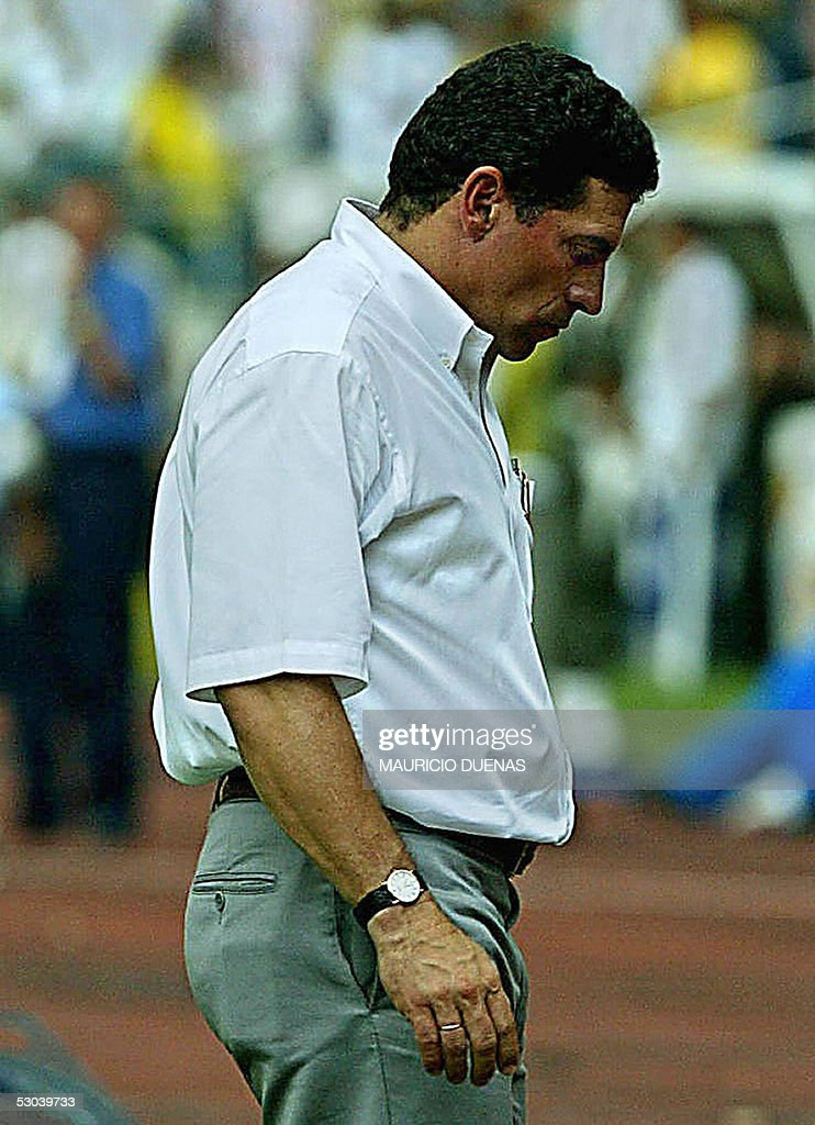 Ecuador's soccer team coach <a gi-track='captionPersonalityLinkClicked' href=/galleries/search?phrase=Luis+Fernando+Suarez+-+Soccer+Coach&family=editorial&specificpeople=548216 ng-click='$event.stopPropagation()'>Luis Fernando Suarez</a> reacts at the endo of their FIFA World Cup Germany-2006 South American qualifying match against Colombia 08 June, 2005 in Barranquilla, Colombia. Colombia defeated Ecuador 3-0. AFP PHOTO/Mauricio DUENAS