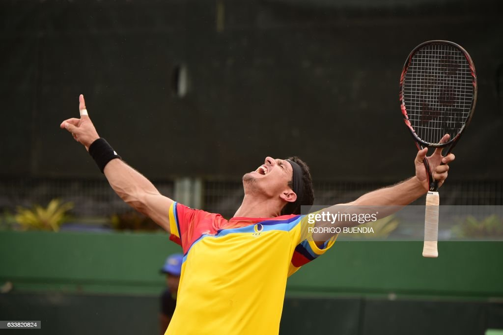 Ecuador's tennis player Emilio Gomez celebrates after winning to Peru's Mauricio Echazu and Jorge Brian Panta (out of frame) in their Davis Cup double match in Guayaquil, Ecuador on February 4, 2017. /