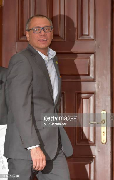 Ecuador's Vice President Jorge Glas gestures upon arrival to present to the press the presidential decree that removes him from all his functions in...