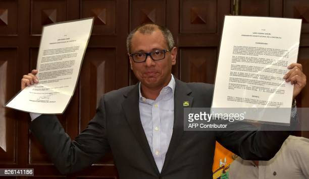 Ecuador's Vice President Jorge Glas shows the presidential decree that removes him from all his functions in Quito on August 3 2017 Ecuador's...