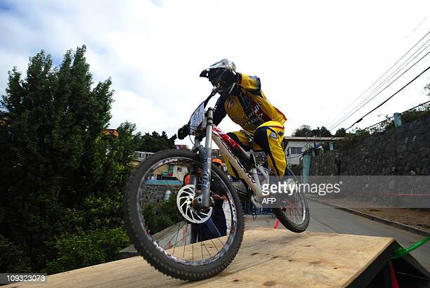 Ecuator's Pro bike downhill rider Mario Jarrin participates in the 9th version of Valparaiso urban downhill race in Chile on February 21 2011 AFP...