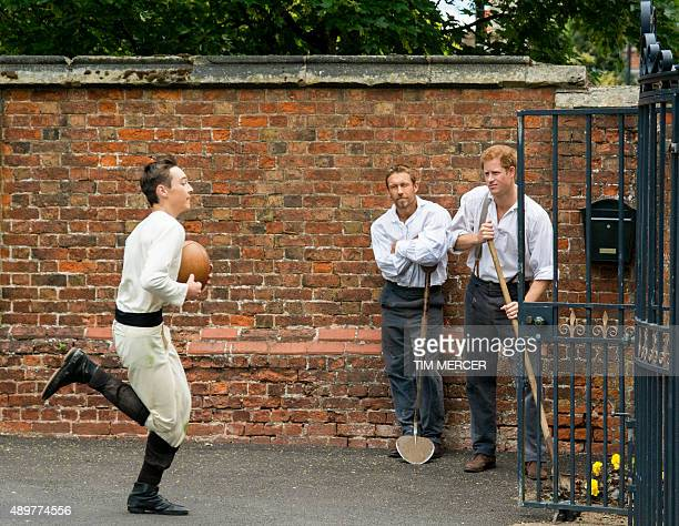 Ed Anthony runs past Jonny Wilkinson and Prince Harry during the making of the Rugby World Cup 2015 Video at the the Rugby School on June 9 2015 in...