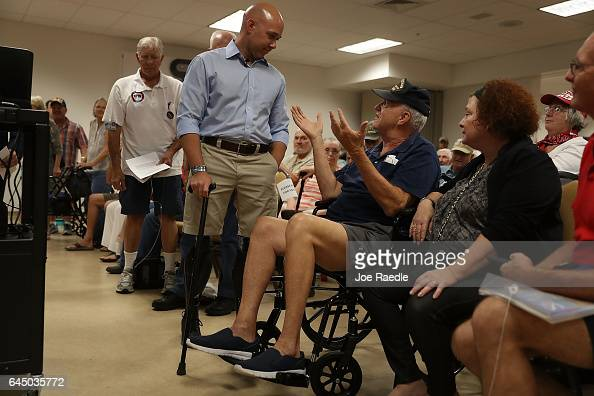 Ed Beckmann speaks with Rep Brian Mast during a town hall meeting at the Havert L Fenn Center on February 24 2017 in Fort Pierce Florida Rep Mast...