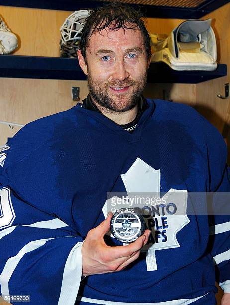 Ed Belfour of the Toronto Maple Leafs holds the game winning puck after the 96 win made him the second best winning goalie beating Terry Sawchuk...