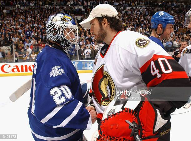 Ed Belfour of the Toronto Maple Leafs shakes hands with Patrick Lalime of the Ottawa Senators during the traditional series ending handshake after...