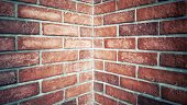 Red brick stone wall texture, Corner of the building. rusty blocks of stone background
