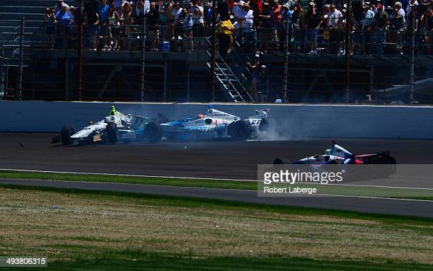 Ed Carpenter driver of the Ed Carpenter Racing Dallara Chevrolet crashes with James Hinchcliffe of Canada driver of the Andretti Autosport during the...